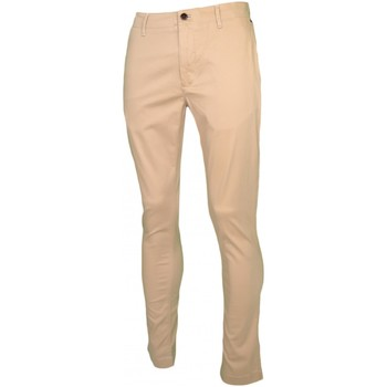 Vêtements Homme Chinos / Carrots Tommy Jeans Pantalon chino  beige slim fit pour homme Beige