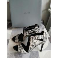 Chaussures Femme Escarpins Minelli Chaussures motifs imitation léopard Multicolore
