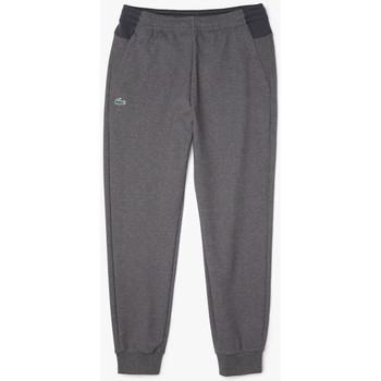 Vêtements Homme Pantalons de survêtement Lacoste Pantalon de jogging  uni avec empiècements en mesh Gris Gris